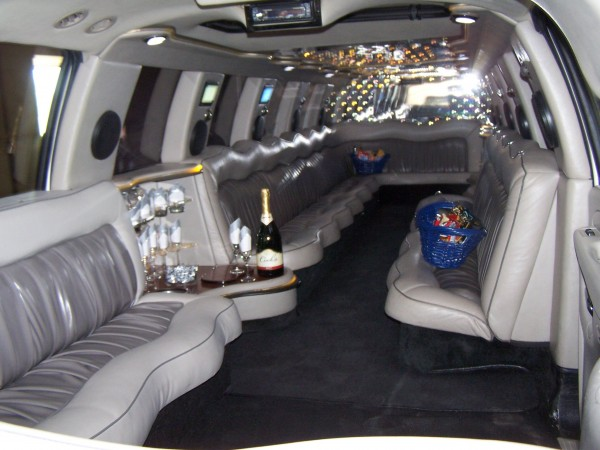 inside Cadillac Escalade Super Stretch Limousine back to front view in Limo